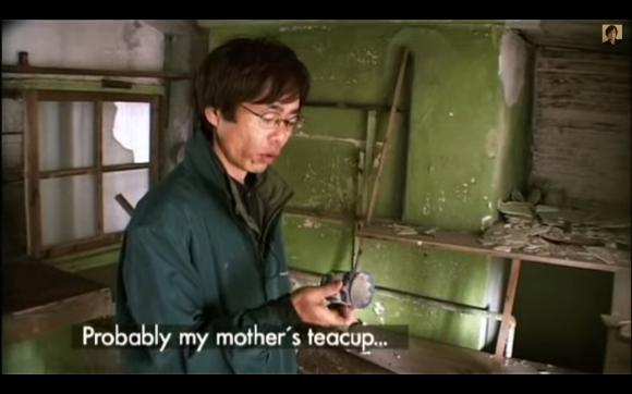 The documentary follows former island resident Dotokou San
