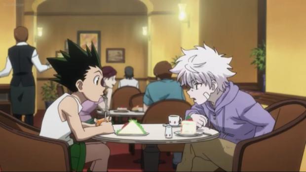 Gon (left) having a munch with his closest friend Kilua